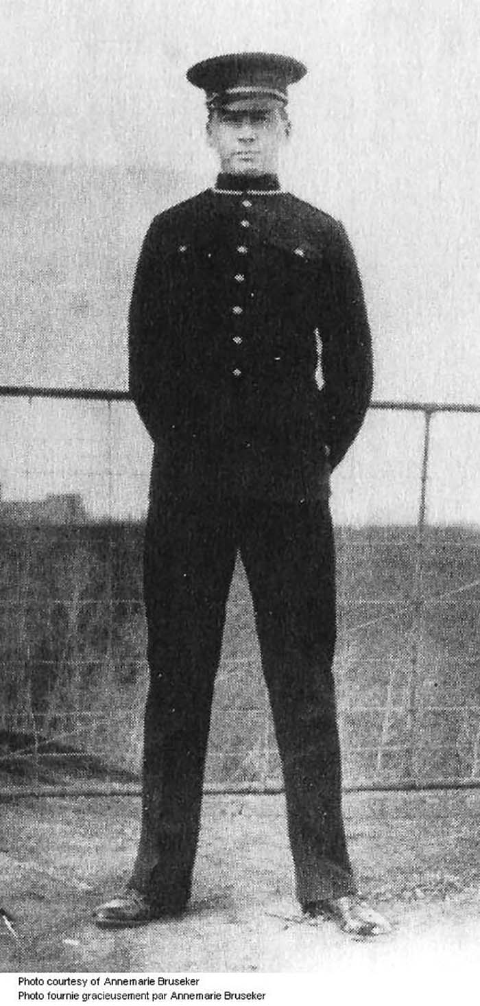 Alex Decoteau in police uniform, 1911